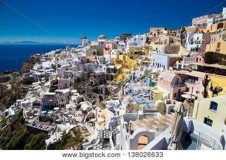 Panoramic view of Oia village at suny day on Santorini island, Greece.