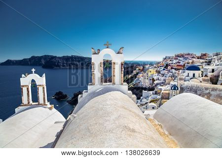 Rings on old church in Oia village at suny day on Santorini island, Greece.