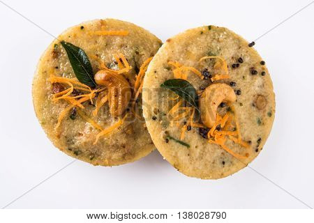 south indian favourite food rava idli or semolina idly or rava idly, served with sambar and green chutney