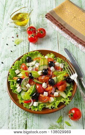Greek salad with fresh vegetables feta cheese and black olives. Healthy fresh vegetarian food