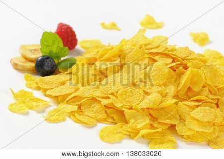 pile of corn flakes on white background - close up