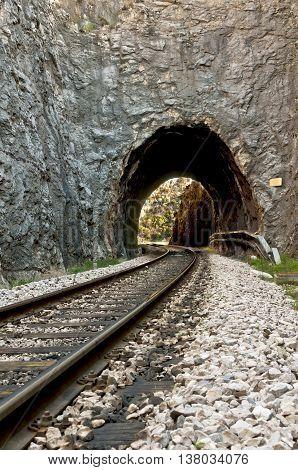 railroad tracks and the tunnel carved in stone entrance in dalmatian hinterland near labin dalmatia croatia