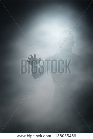 Editable vector illustration of a man reaching through fog created using gradient meshes