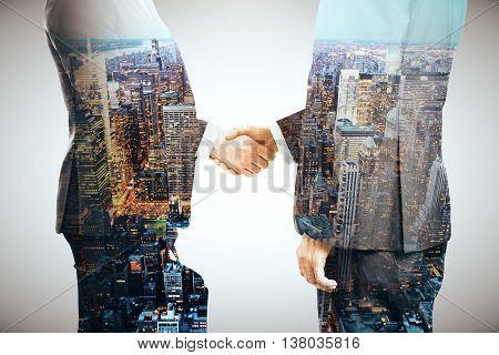 Businessmen Shaking Hands Multiexposure