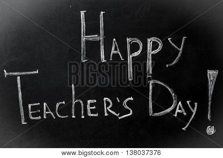 chalk inscription happy teacher's day on black Board stylish
