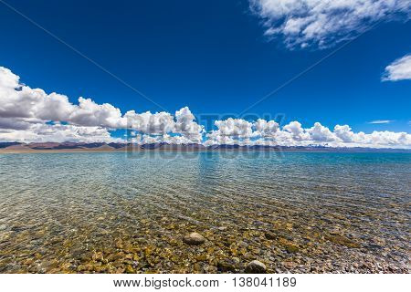Stunning view of Namtso Lake and Nyenchen Tanglha Mountains in Tibet China.