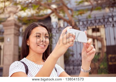 Brunette Girl Taking Cell Phone Pictures