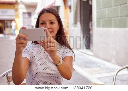 Happily Smiling Young Girl Taking Pictures