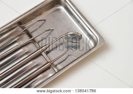 Dental instruments: professional dental tool set closeup.