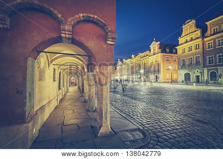 Retro Stylized Old Market Square In Poznan At Night.