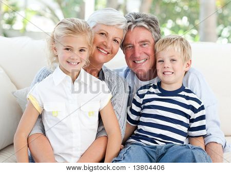 Happy family looking at the camera
