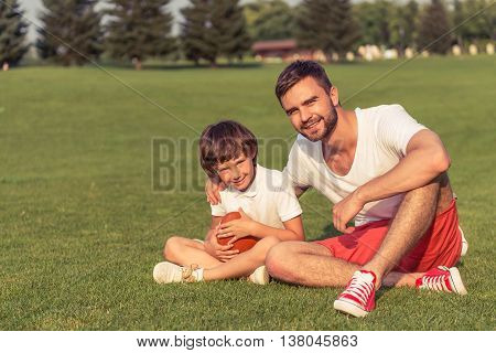 Dad And Son Resting Outdoors