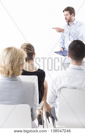 Business people during important meeting with a boss talking about company's strategy