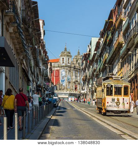 Tram Near To Santo Ildefonso Church In Porto. Portugal.