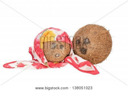 Two coconut. One with a handkerchief as a woman and second as a man a loving couple isolated on white background
