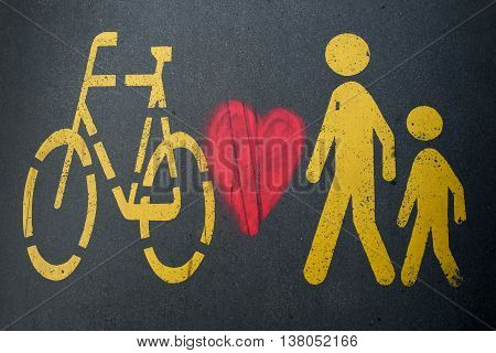 Pedestrian/bike sign and heart on the black background