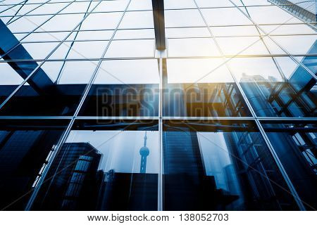 oriental pearl tower reflected on glass