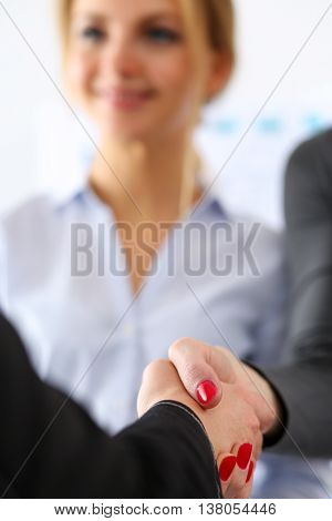 Two Businesswoman Shake Hands As Hello