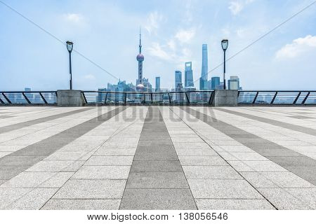 empty pavement and the bund skyline,copy space