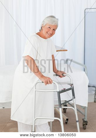 Senior woman looking at the camera with her zimmer frame