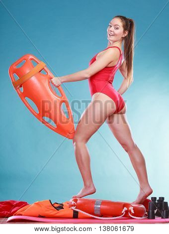 Lifeguard On Duty With Rescue Buoy.