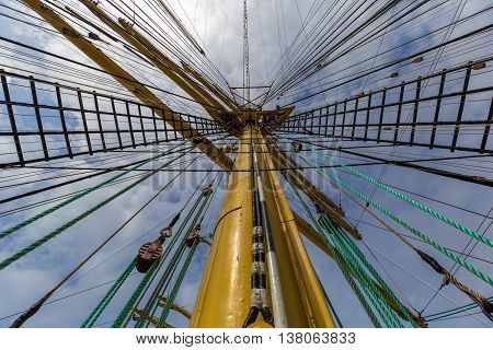 Upwards view of the ship's yellow mast