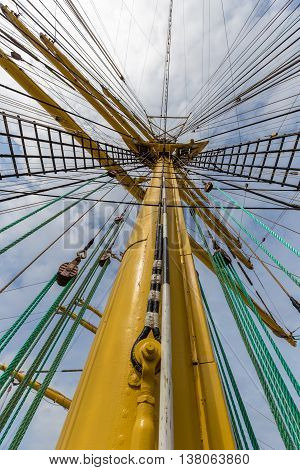 Upwards view of a ship yellow mast