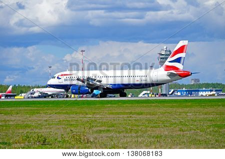 ST PETERSBURG RUSSIA - MAY 11 2016. G-EUUC .British Airways Airbus A320 airplane. Airplane rides on the runway after arrival in Pulkovo International airport in St Petersburg Russia