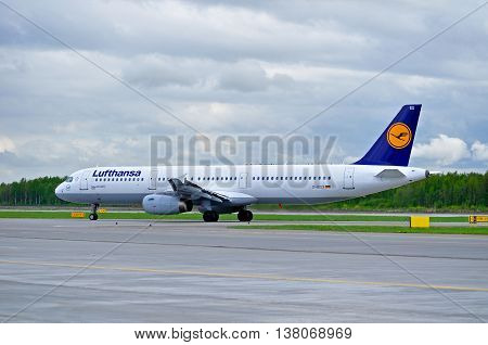 ST PETERSBURG RUSSIA - MAY 11 2016. D-AISX Lufthansa Airbus A321 airplane closeup. Airplane rides on the runway after arrival in Pulkovo International airport in St Petersburg Russia