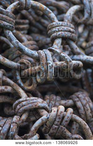 Iron links join iron rings in chaotic mass of rusting chain