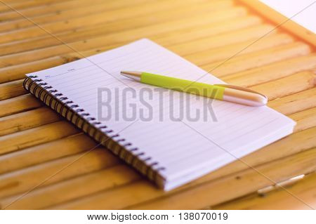blank open notepad and pen on wood background,office view images by category