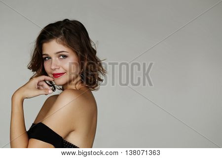 Beautiful girl in evening dress and red lipstick