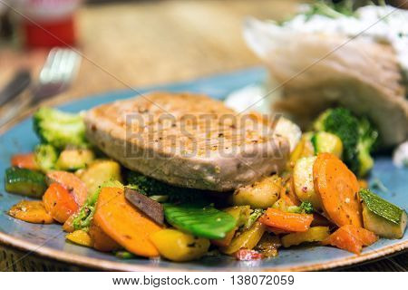 pork chop-delicious juicy pork chop with many vegetables