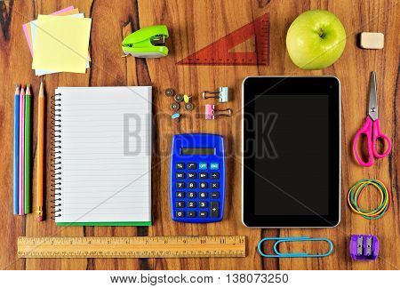 School Supplies Flat Lay On Wooden Desk With Notebook And Tablet