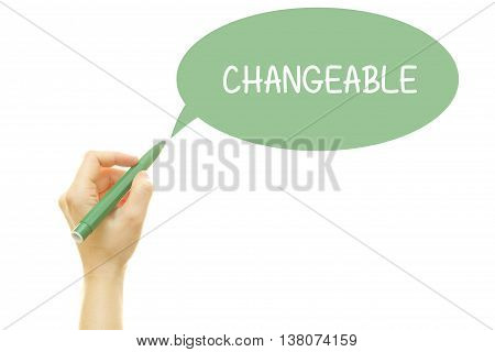 Woman hand writing CHANGEABLE with a marker isolated on white.