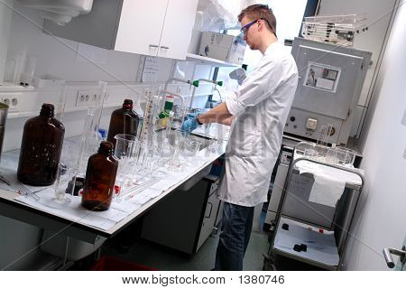 Professor Cleaning In The Laboratory