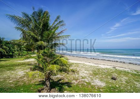 Layang Layang tropical beach,at Labuan island on sunny day,which won the Clean Beach Award 2008.This is the place to view sunset with long stretch of beach fringed & coconut trees