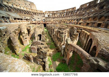 On first circle of arena in ancient Coliseum in Rome, Italy at sunny day