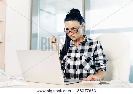 business woman working on laptop, office life