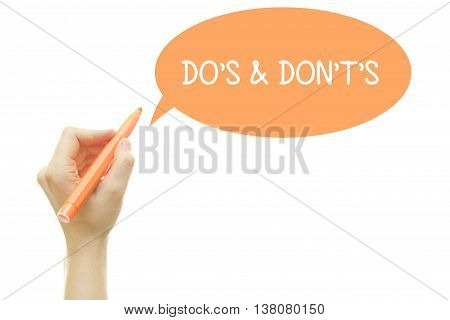 Woman hand writing Do's and Don't's Message with a marker isolated on white.