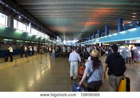 FIUMICINO, ITALY - AUGUST 6: Crowd people in passageway for registration inside Leonardo da Vinci-Fiumicino Airport - largest airport in Italy on August 6, 2010 in Fiumicino near Rome, Italy.