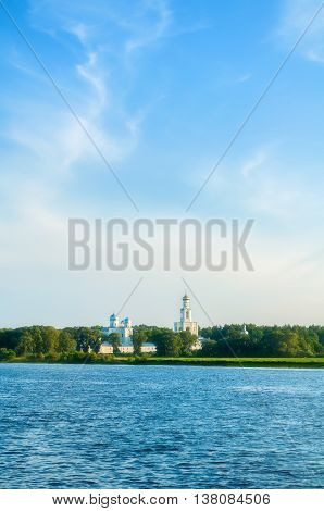 Summer architecture view -architecture ensemble of Yuriev monastery on the bank of Volkhov river in Veliky Novgorod Russia. Sunset summer architecture view of architecture Orthodox landmark