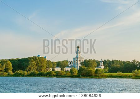 Architecture panoramic landscape - view of architecture ensemble of Yuriev monastery on the bank of Volkhov river in Veliky Novgorod Russia sunset summer architecture view of Orthodox landmark
