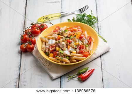 cold pasta salad with octopus capsicum and hot chili pepper