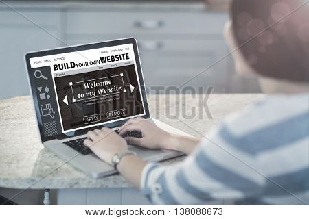 Composite image of build website interface against woman using a laptop in the kitchen