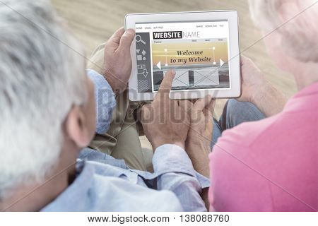 Composite image of build website interface against overhead of couple using computer tablet
