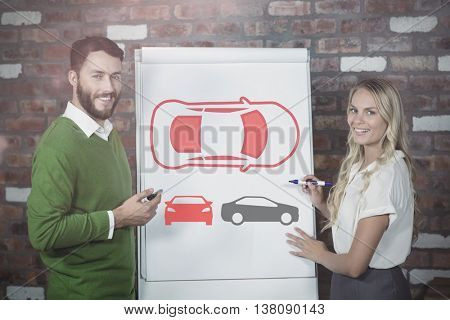 Overhead view of car icon against portrait of smiling colleagues while preparing presentation