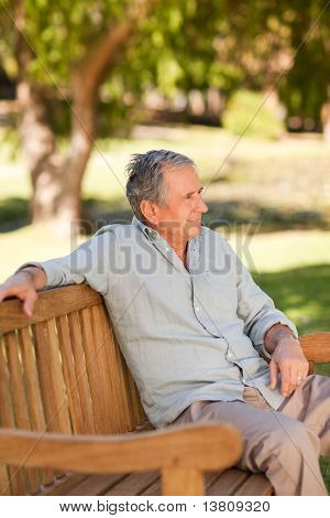Senior Man Sitting On A Bench