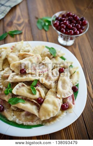 boiled dumplings stuffed with cherries on a plate