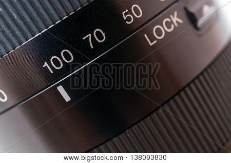 Macro shot of black camera lens. Photography concept.